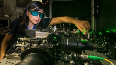 Rocio Camacho-Morales, a PhD candidate at the Australian National University. Here she adjusts the laser equipment in the laboratory of the Nonlinear Physics Centre at the ANU