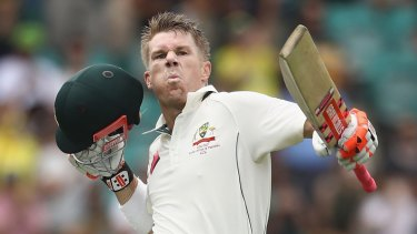 Happier times: David Warner after thumping a century for Australia.