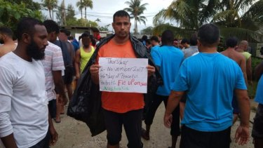 Refugees and asylum seekers protesting inside the now-closed regional processing facility on Manus Island, which they refuse to leave.