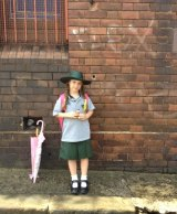 Abi Ulgiati's daughter Minnie Mai was left without after school care like hundreds of other Sydney children.
