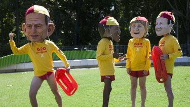 Oxfam activists dressed as world leaders in lifeguard uniforms during a protest in Brisbane on Friday.