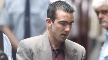 Jason Roberts is led into court in December 2002.