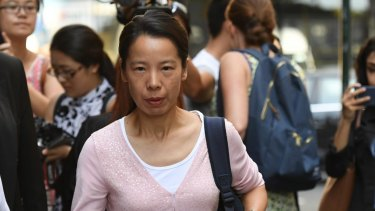 Kathy Lin, the wife of Robert Xie, leaves court on Friday.