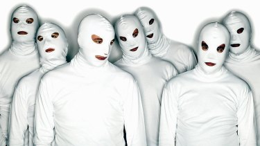 The masked members of TISM in 2004.