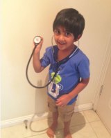 Sufi with his father's stethoscope.