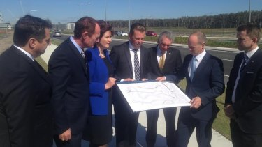 """""""Team Sunshine Coast"""": (from left) Environment Minister and Glass House MP Andrew Powell, Racing Minister and Buderim MP Steve Dickson, Maroochydore MP and Speaker Fiona Simpson, Transport Minister Scott Emerson, Member for Caloundra and Energy Minister Mark McArdle, Premier Campbell Newman and Attorney-General and Member for Kawana Jarrod Bleijie."""
