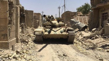 Iraqi security forces in al-Julan neighbourhood of Fallujah after defeating Islamic State militants on Sunday.