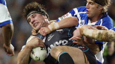 Former Penrith front-rower Martin Lang is rocked in a tackle against the Bulldogs in 2004.