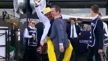 Neil Paine (yellow trousers) celebrates with Adrian Bott after winning Golden Slipper with Farnan.