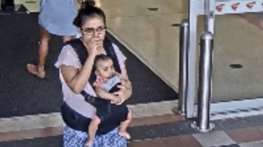 Security camera footage showing the mother with their baby girl at Buranda Village shopping centre on November 15.