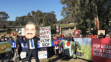 Anti-Adani protesters gathered Saturday outside the Indian High Commission in Canberra, with a smaller group also staging an event at the country's consulate in Sydney.