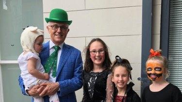 Former prime minister Malcolm Turnbull with Astrid Gardan, Saskia Gardan and Sofia White, trick or treating for Halloween.