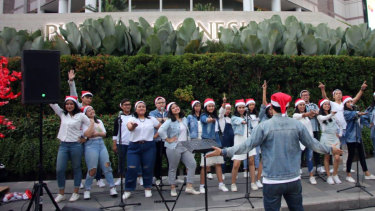 University choirs help stage the first official Christmas carols in Jakarta.