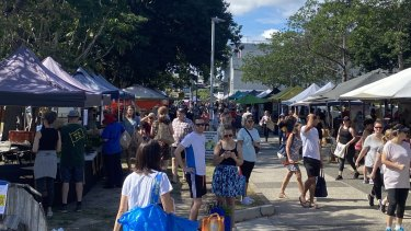 Shoppers atJan Powers Farmers Market at the Brisbane Powerhouse on Saturday ignore the social-distancing requirements.