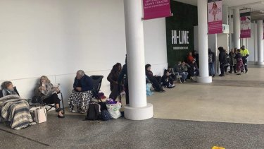 Hundreds of people line up outside Crown Perth to purchase grand final tickets on Thursday morning.