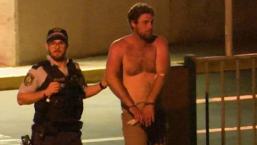 Alleged drink-driver Samuel Davidson is led away by police.