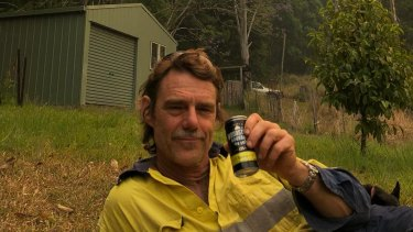 Jim Tait, exhausted after fighting fires on  on his property in northern NSW.