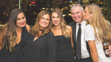 Danny Frawley with his wife Anita and their three daughters.