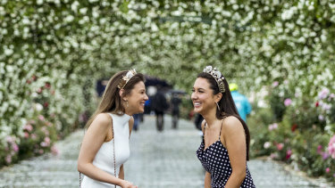 Jessica Moro and Claudia Del Solar arrive for a wet Derby Day at Flemington Racecourse.