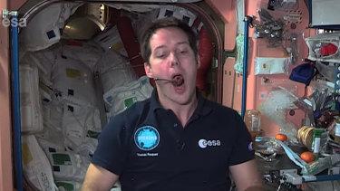 ESA astronaut Thomas Pesquet takes a bite.