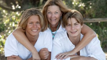 Monika Zwolsman with her sons Yannick, left, and Soren Zwolsman. Ms Zwolsman is angry a photo taken three years ago of her son Soren wearing girl's bathers at a swim meet was misrepresented to allege bullying in the sport.