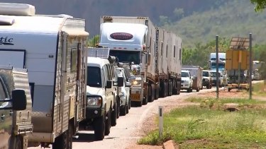 Hundreds of cars line up at the WA-NT border.