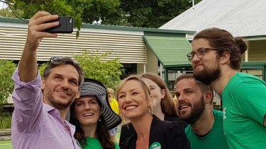 Queensland Greens senator Larissa Waters (centre) posing for a photo at Rainworth State School on Saturday with supporters and state member for Maiwar Michael Berkman.