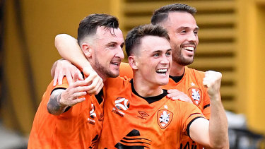 Roy O'Donovan, left, celebrates his goal against the Mariners on Saturday.
