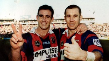 Old firm: Andrew and Matthew Johns celebrate the latter's final home game in 2000.