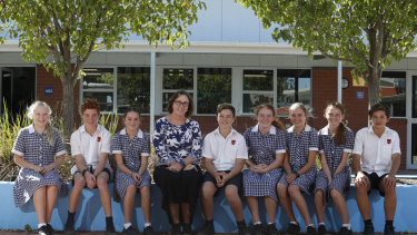 Moama Anglican Grammar principal Carmel Spry with students who attend the border school in NSW.