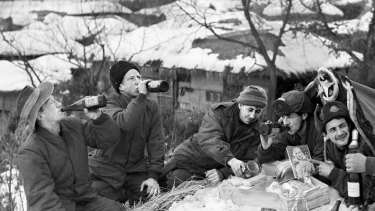 Australian troops enjoy a beer, food and Christmas parcels from the RSL during the Korean War.