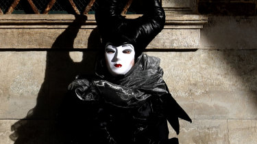 A woman in full costume for Venice Carnival, which was on Sunday cancelled due to the coronavirus outbreak.