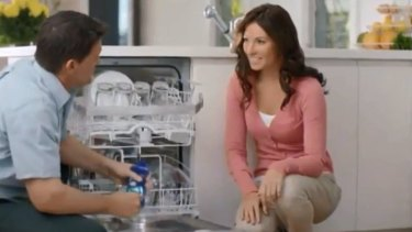 An advert for the Finish cleaning product features a male expert telling a woman how to clean her dishwasher.