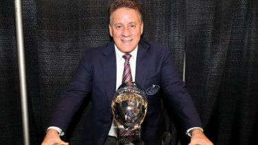 Outback Bowl president Jim McVay poses with the game's trophy from last season.