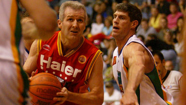 Throwback: Mike Kelly, then playing for Townsville, guards Andrew Gaze.