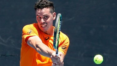 No. 1 seed Alex Bolt, before his new look, plays a backhand against Benard Nkomba in last year's Australian Open Wild Card play-offs.