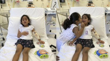 Tharnicaa and her sister Kopika in hospital on Christmas Island on June 6.