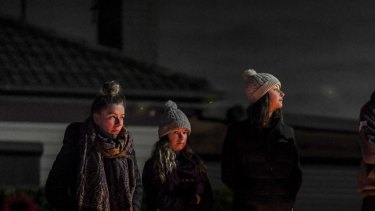 The Larkins family in Clara Street, Macleod at a small dawn service in their street on Anzac day.
