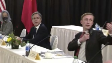 US National Security Adviser Jake Sullivan gesturing for cameras to remain in the room amid a heating exchange between the US and Chinese diplomats.