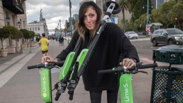 """Juicer"" Livia Looper pushes Lime scooters in San Francisco, California."