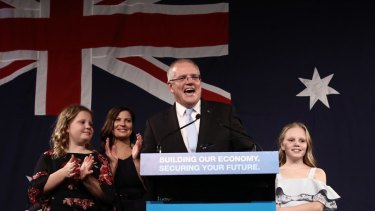 Scott Morrison takes to the stage with wife Jenny and children Abbey and Lily to declare victory.
