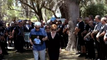 A photo of Nick Martin leads the start of the funeral.