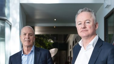 The court has approved the merger of Nine and Fairfax Media. Fairfax CEO Greg Hywood, left, and Nine boss Hugh Marks.