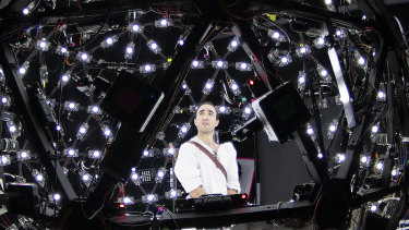 Performer Brenton Spiteri is recorded in front of 90 cameras and 300 different lights to produce volumetric measures, which become the basis of the avatar standing before a person.