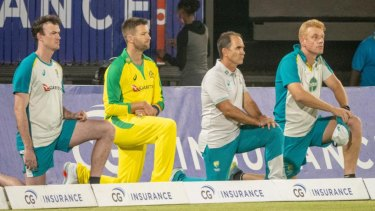 The Australian team takes a knee before a T20 clash with the West Indies.