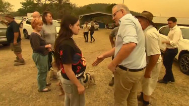 Zoey McDermott refuses to shake the hand of the Prime Minister during his visit to Cobargo.
