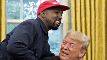 Rapper Kanye West, left, shakes hands with US President Donald Trump during a meeting in the Oval Office of the White House in Washington, DC.