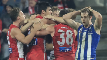 Upset: The Swans celebrate their unexpected victory over North Melbourne.