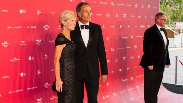 Former Foreign Affairs Minister Julie Bishop and David Patton arrive at the MAAS Fashion Ball at the Powerhouse Museum in Sydney.