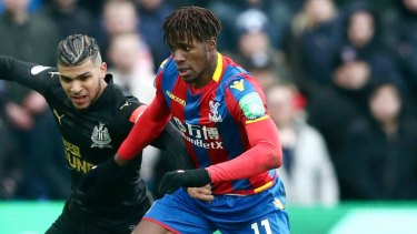 In demand: Wilfried Zaha, right, and Newcastle United's DeAndre Yedlin battle for the ball.